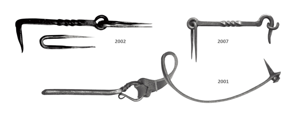 Twisted hooks and an 18th-century sash pin.